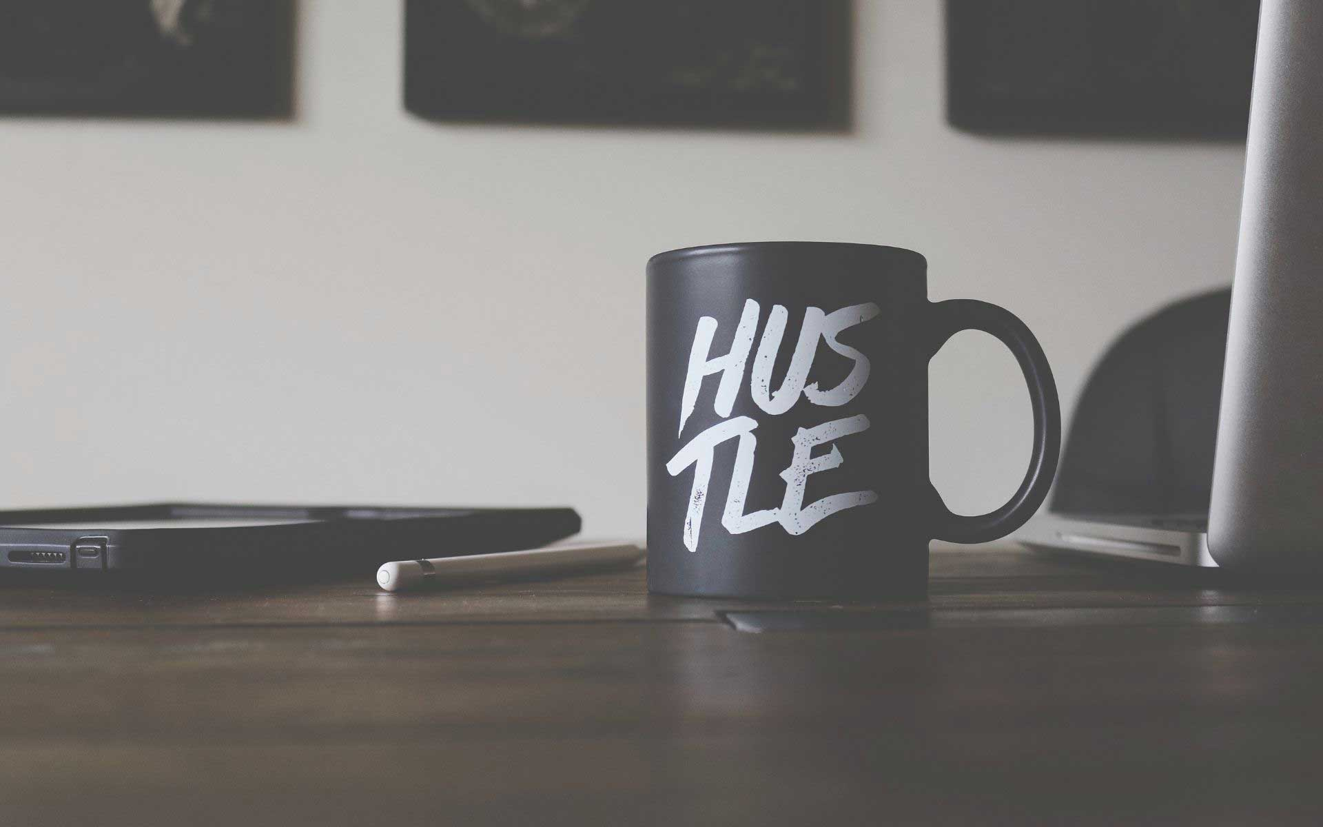mug with hustle written on it