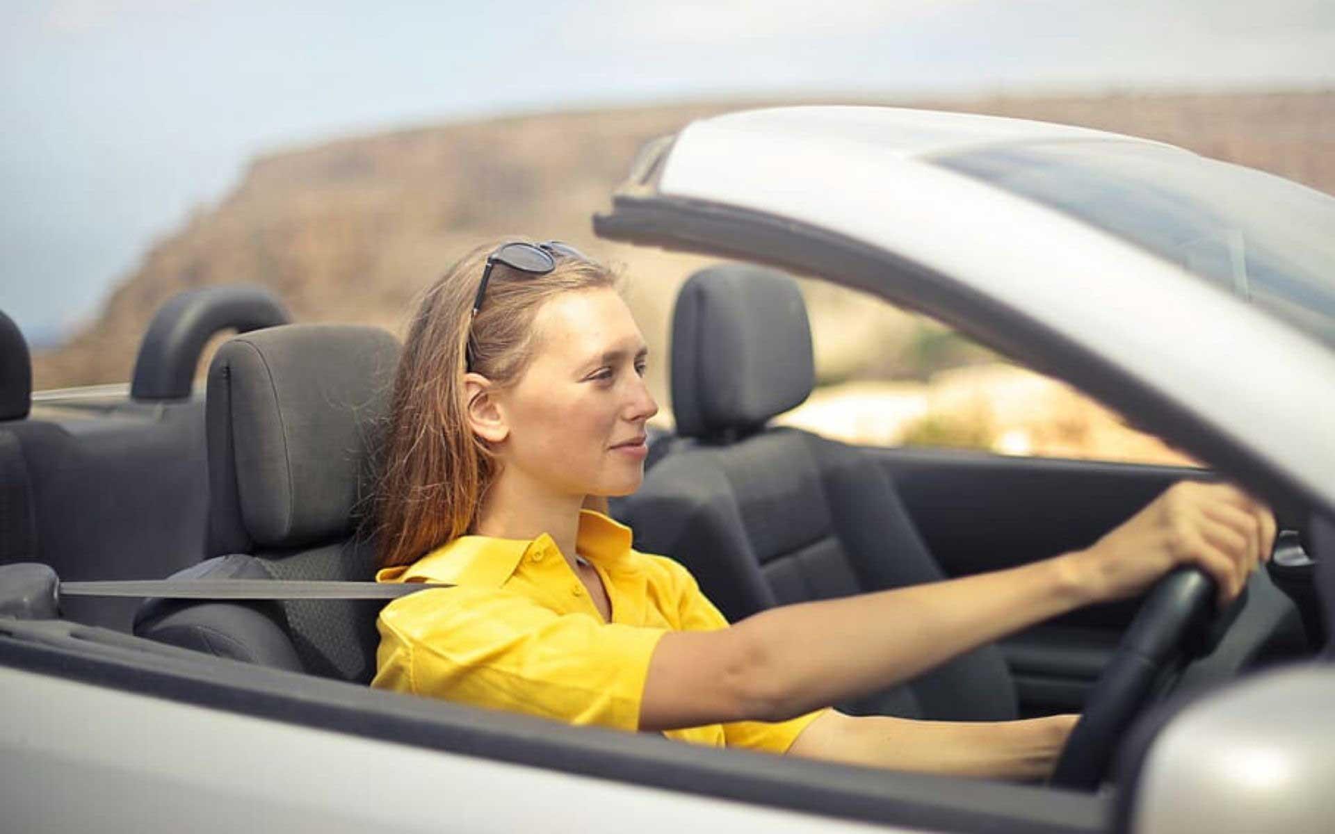 woman driving a convertable car